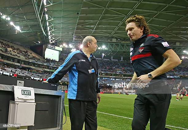 James Hird coach of the Essendon Bombers heads to the exit as he walks to the coaches box during the round 20 AFL match between the Essendon Bombers...