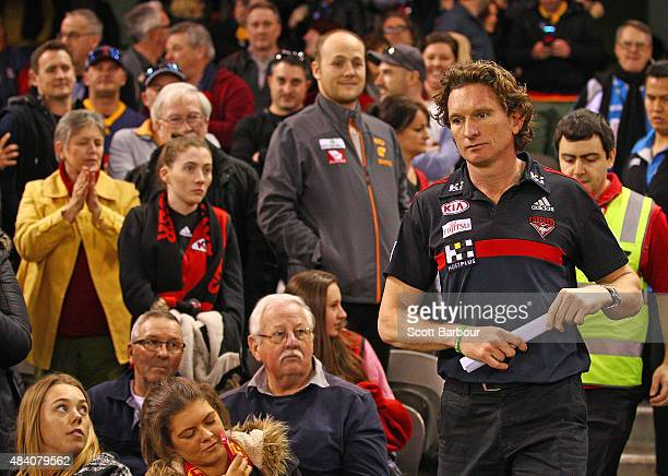 James Hird coach of the Essendon Bombers walks through Bombers supporters in the crowd at the end of the match during the round 20 AFL match between...