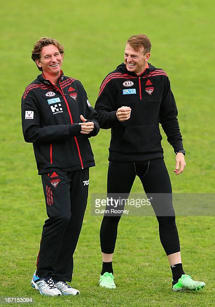 James Hird the coach of the Bombers and Brendon Goddard have a laugh during an Essendon Bombers AFL training session at Windy Hill on April 22 2013...