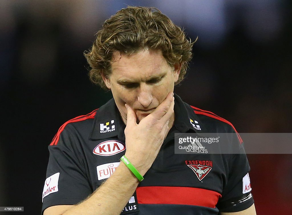 James Hird the coach of the Bombers looks dejected as he leaves the field after losing the round 14 AFL match between the Essendon Bombers and the St...
