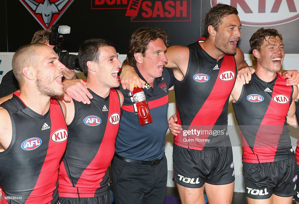 James Hird the coach of the bombers sings the song with David Zaharakis Brent Stanton Tom Bellchambers and Jake Melksham of the Bombers after winning...