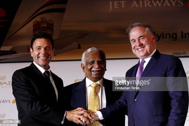James Hogan President and CEO of Etihad Airways Naresh Goyal Chairman of Jet Airways and Cramer Ball CEODesignate of Jet Airways during a joint press...