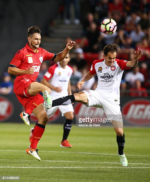James Holland of Adelaide United competes competes with Steven Lustica of the Wanderers during the round two ALeague match between Adelaide United...