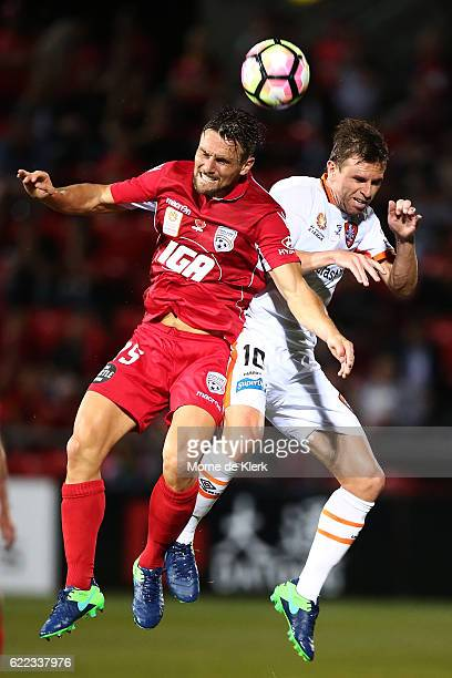 James Holland of Adelaide United competes in the air with Brett Holman of Brisbane Roar during the round six ALeague match between Adelaide United...