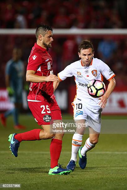 James Holland of Adelaide United competes with Brett Holman of Brisbane Roar during the round six ALeague match between Adelaide United and Brisbane...