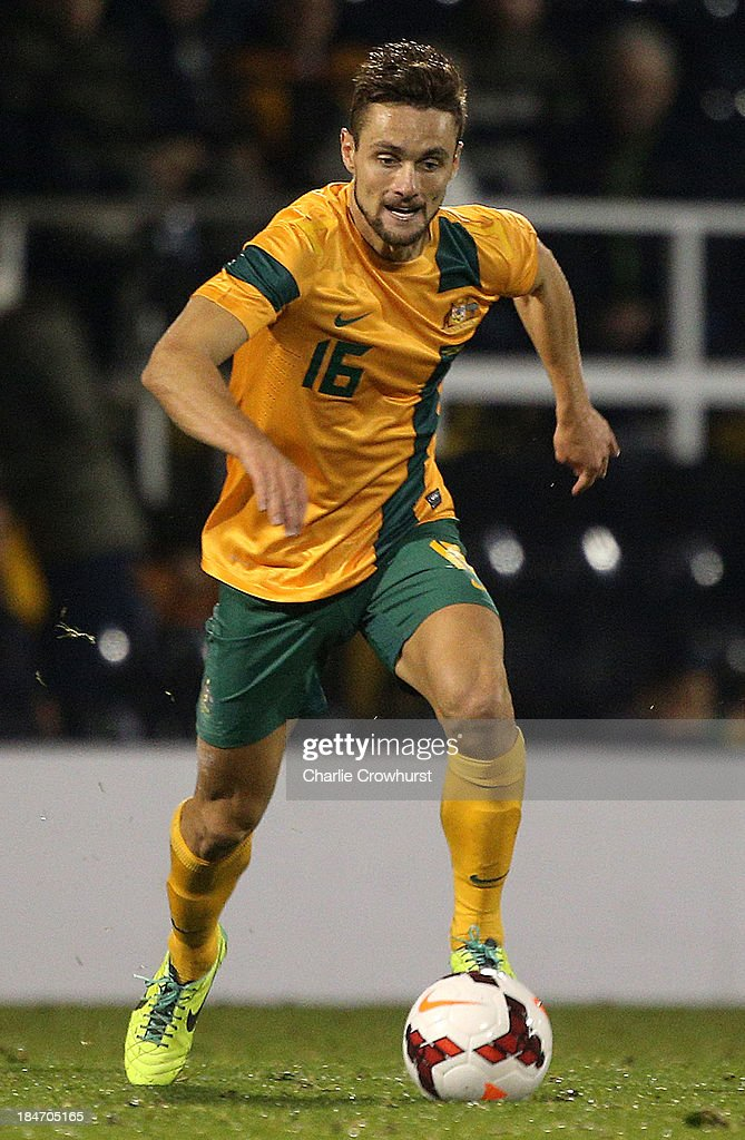 <a gi-track='captionPersonalityLinkClicked' href=/galleries/search?phrase=James+Holland&family=editorial&specificpeople=1647686 ng-click='$event.stopPropagation()'>James Holland</a> of Australia looks to attack during the International Friendly match between Canada and Australia at Craven Cottage on October 15, 2013 in London, England.