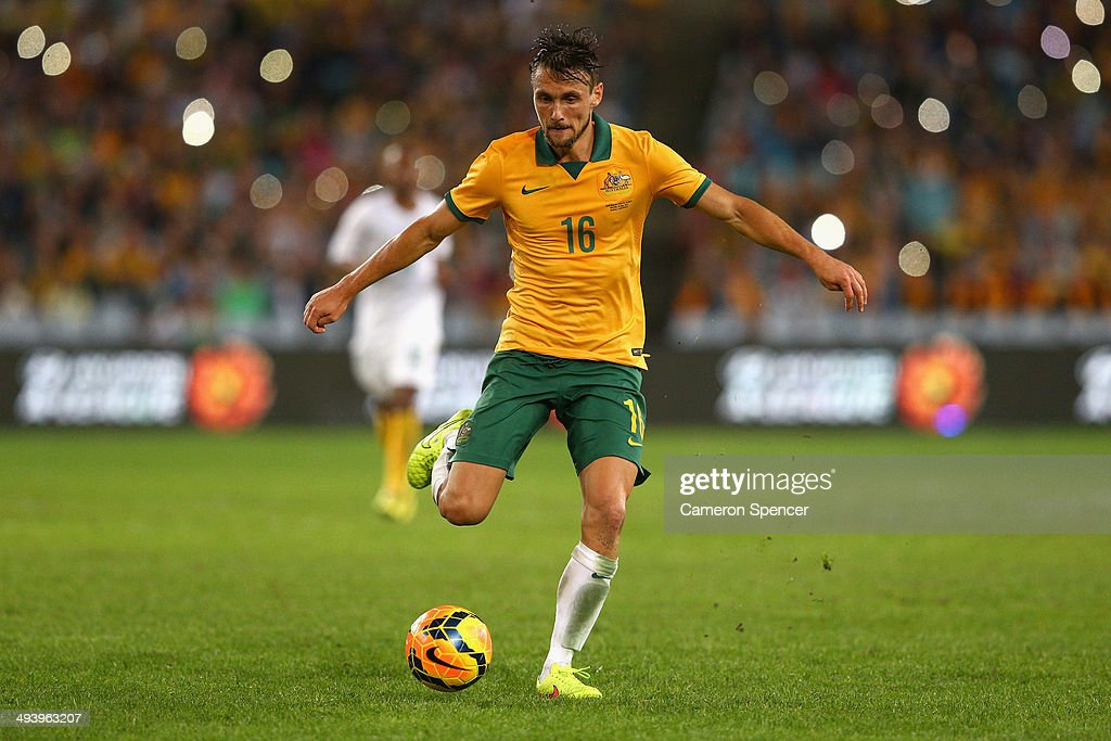 <a gi-track='captionPersonalityLinkClicked' href=/galleries/search?phrase=James+Holland&family=editorial&specificpeople=1647686 ng-click='$event.stopPropagation()'>James Holland</a> of the Socceroos controls the ball during the International Friendly match between the Australian Socceroos and South Africa at ANZ Stadium on May 26, 2014 in Sydney, Australia.