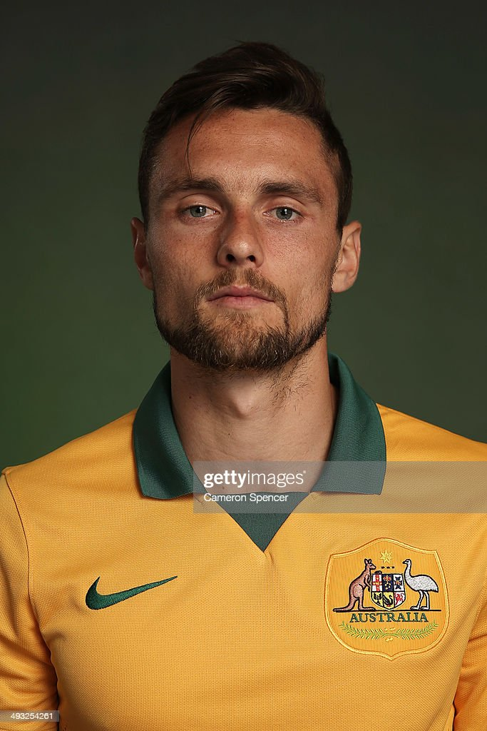 <a gi-track='captionPersonalityLinkClicked' href=/galleries/search?phrase=James+Holland&family=editorial&specificpeople=1647686 ng-click='$event.stopPropagation()'>James Holland</a> of the Socceroos poses during an Australian Socceroos portrait session at Crowne Plaza Terrigal on May 20, 2014 in Sydney, Australia.