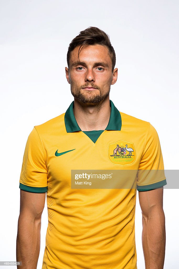 <a gi-track='captionPersonalityLinkClicked' href=/galleries/search?phrase=James+Holland&family=editorial&specificpeople=1647686 ng-click='$event.stopPropagation()'>James Holland</a> poses during an Australian Socceroos headshots session at Crowne Plaza Terrigal on May 20, 2014 in Sydney, Australia.