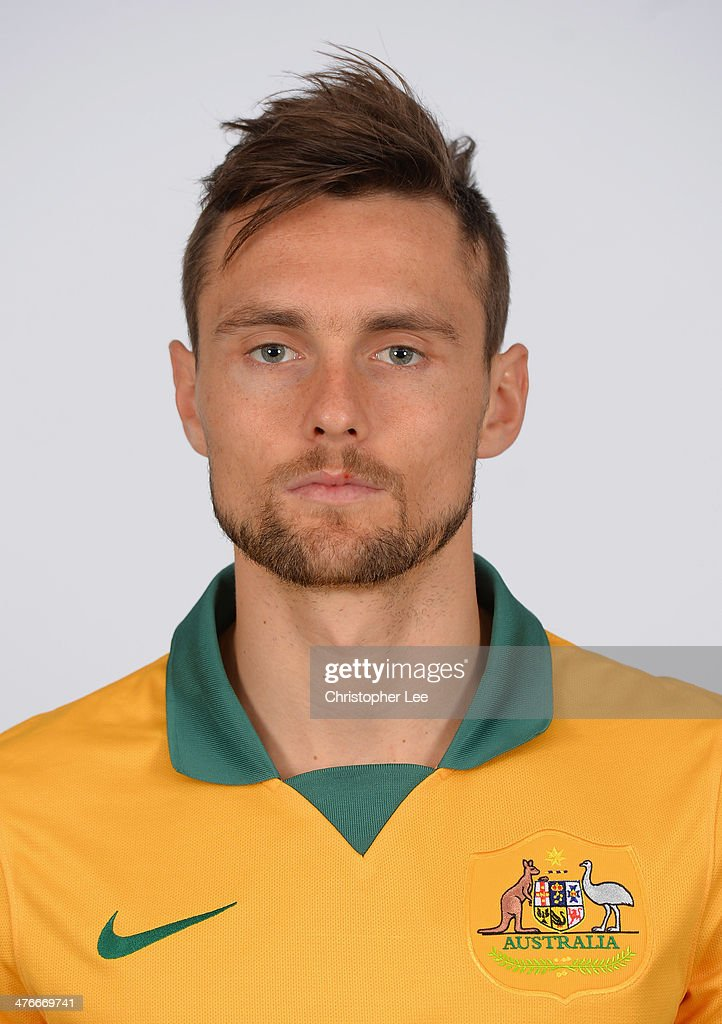 <a gi-track='captionPersonalityLinkClicked' href=/galleries/search?phrase=James+Holland&family=editorial&specificpeople=1647686 ng-click='$event.stopPropagation()'>James Holland</a> poses for camera during the Socceroos Photocall at the Hotel Verta on March 4, 2014 in Battersea, England.