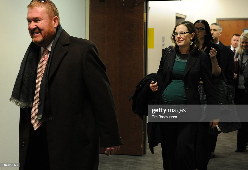 James Holmes defense team enter the second floor of the Arapahoe County Courthouse, Friday, January 11, 2013 on their way to the courtroom. The arraignment for Aurora theater shooting suspect James Holmes was postponed until March 2013 for the July 20 shooting at the Century 16 theater that killed 12 people and injured 70 others.