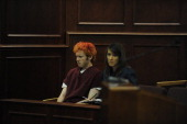 James Holmes the man accused of killing 12 people and injuring 58 others in the movie theater shooting sits with Tamara Brady a public defender as he...