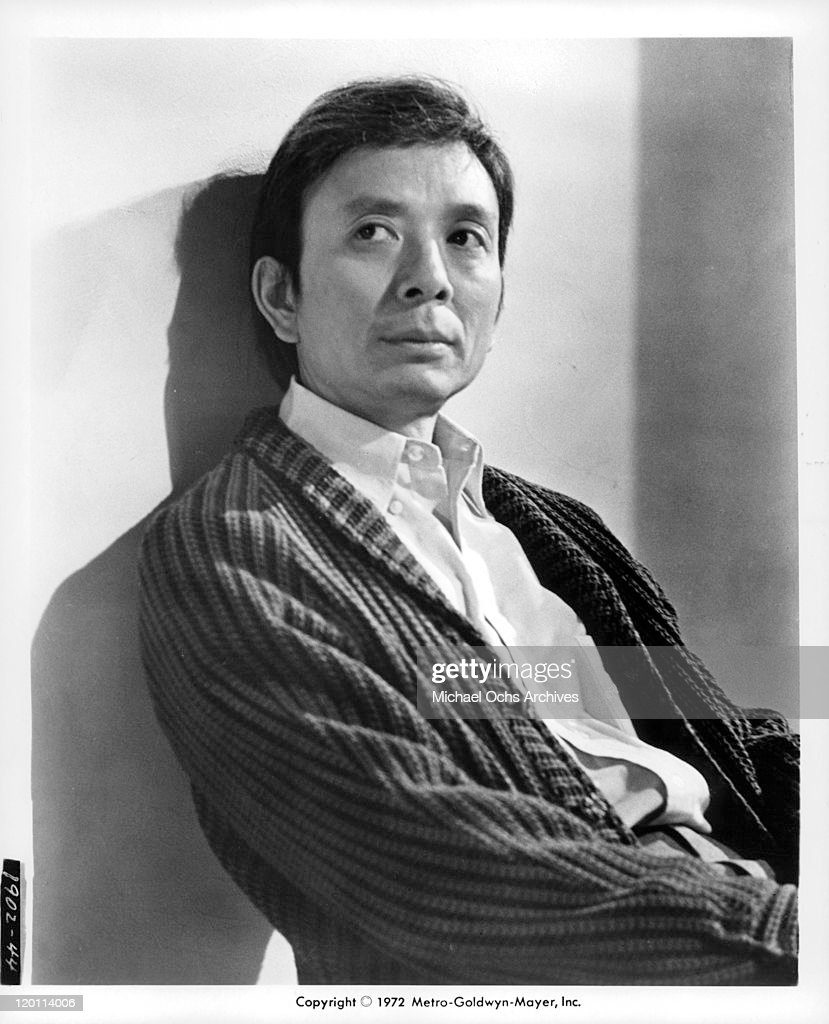 James Hong leaning against the wall in a scene from the film 'The Carey Treatment' 1972