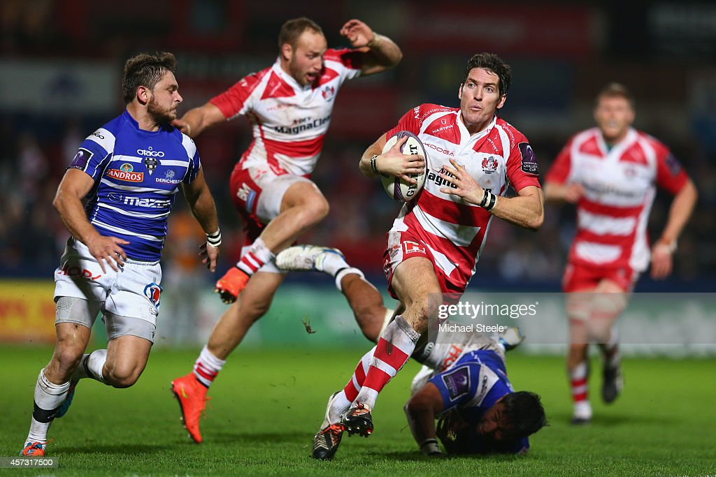 James Hook (C) of Gloucester bursts past the challenge from Poutasi Luafutu (R) of Brive during the European Rugby Challenge Cup Pool 5 match between Gloucester Rugby and Brive at Kingsholm Stadium on October 16, 2014 in Gloucester, England.