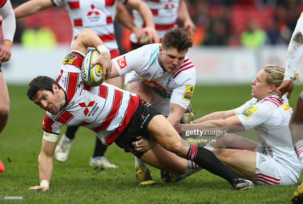 <a gi-track='captionPersonalityLinkClicked' href=/galleries/search?phrase=James+Hook&family=editorial&specificpeople=710391 ng-click='$event.stopPropagation()'>James Hook</a> of Gloucester gets away from a tackle byHarry Sloan and Matt Hopper of Quins befoe he scores a try during the Aviva Premiership match between Gloucester Rugby and Harlequins at Kingsholm Stadium on February 13, 2016 in Gloucester, England.
