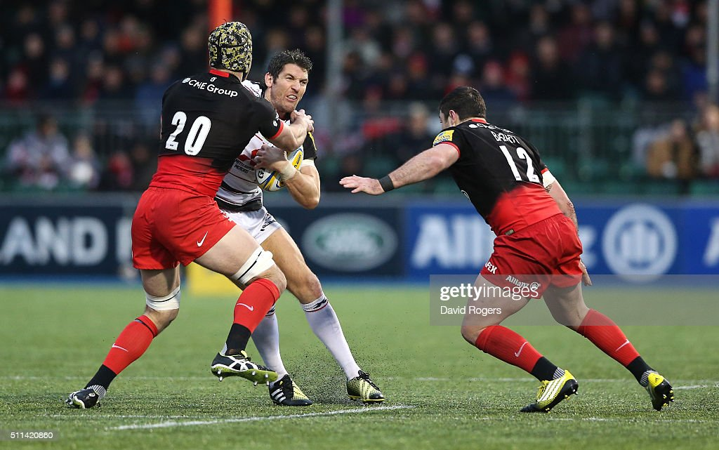 <a gi-track='captionPersonalityLinkClicked' href=/galleries/search?phrase=James+Hook&family=editorial&specificpeople=710391 ng-click='$event.stopPropagation()'>James Hook</a> of Gloucester is tackled by <a gi-track='captionPersonalityLinkClicked' href=/galleries/search?phrase=Kelly+Brown+-+Rugby+Player&family=editorial&specificpeople=211000 ng-click='$event.stopPropagation()'>Kelly Brown</a> during the Aviva Premiership match between Saracens and Gloucester at Allianz Park on February 20, 2016 in Barnet, England.