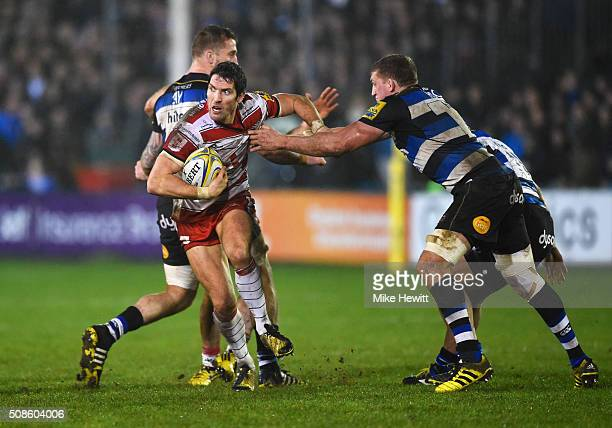 James Hook of Gloucester Rugby evades Stuart Hooper of Bath Rugby during the Aviva Premiership match between Bath Rugby and Gloucester Rugby at the...