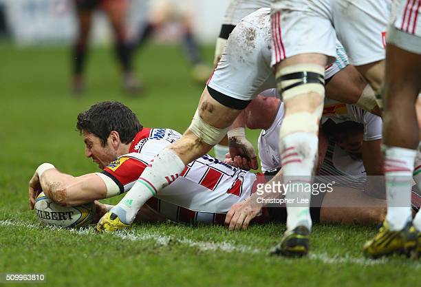 James Hook of Gloucester scores their first try during the Aviva Premiership match between Gloucester Rugby and Harlequins at Kingsholm Stadium on...