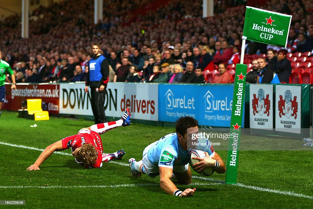 James Hook (R) of Perpignan scores the opening try as Billy Twelvetrees (L) of Gloucester fails to tackle during the Heineken Cup Pool six match between Gloucester and USA Perpignan at Kingsholm Stadium on October 12, 2013 in Gloucester, England.
