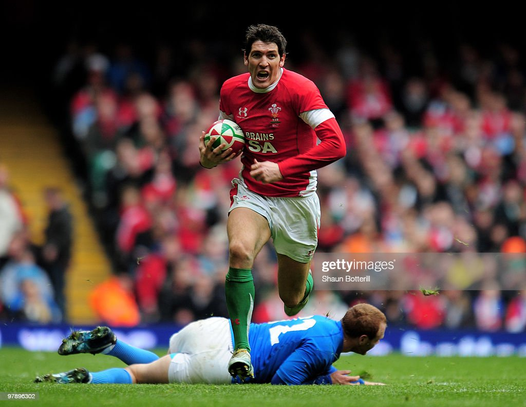 <a gi-track='captionPersonalityLinkClicked' href=/galleries/search?phrase=James+Hook&family=editorial&specificpeople=710391 ng-click='$event.stopPropagation()'>James Hook</a> of Wales breaks through the tackle of Gonzalo Garcia of Italy during the RBS Six Nations match between Wales and Italy at Millennium Stadium on March 20, 2010 in Cardiff, Wales.