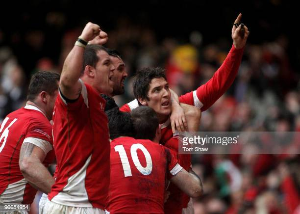 James Hook of Wales celebrates with his team mates after Shane Williams scored the winning try during the RBS 6 Nations match between Wales and...