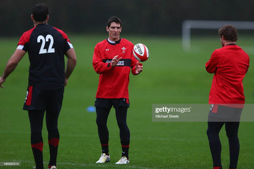 <a gi-track='captionPersonalityLinkClicked' href=/galleries/search?phrase=James+Hook&family=editorial&specificpeople=710391 ng-click='$event.stopPropagation()'>James Hook</a> (C) of Wales during the Wales training session at Vale Resort on January 29, 2013 in Cardiff, Wales.