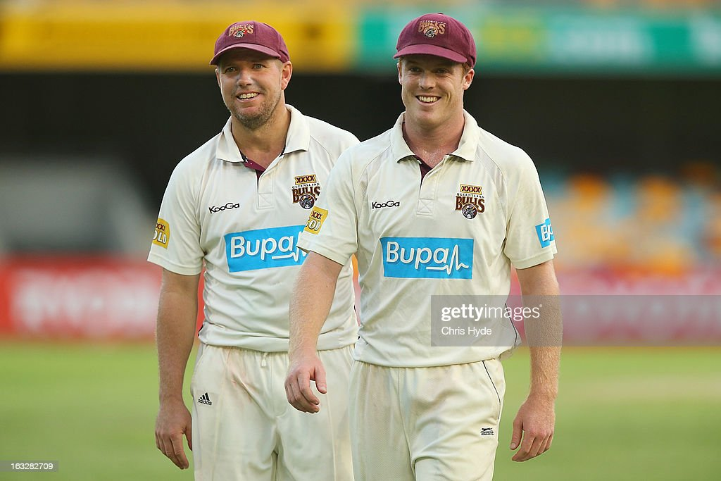 James Hopes and Alister McDermott of the Bulls leave the field at the end of play on day one of the Sheffield Shield match between the Queensland Bulls and the Tasmanian Tigers at The Gabba on March 7, 2013 in Brisbane, Australia.