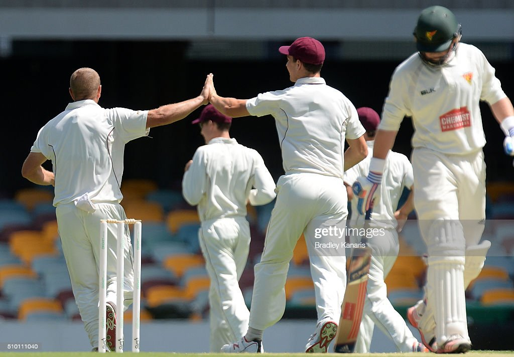 James Hopes of Queensland celebrates with team mates after taking the wicket of Ben Dunk of Tasmania during day one of the Sheffield Shield match between Queensland and Tasmania at The Gabba on February 14, 2016 in Brisbane, Australia.