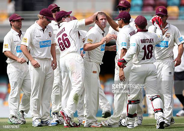 James Hopes of the Bulls celebrates with team mates after dismissing Chadd Sayers of the Redbacks during day three of the Sheffield Shield match...