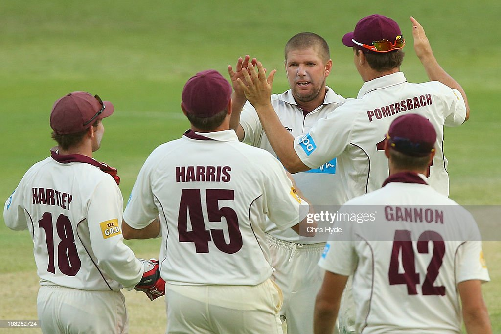 <a gi-track='captionPersonalityLinkClicked' href=/galleries/search?phrase=James+Hopes&family=editorial&specificpeople=208940 ng-click='$event.stopPropagation()'>James Hopes</a> of the Bulls celebrates with team mates after dismissing Jon Wells of the Tigers during day one of the Sheffield Shield match between the Queensland Bulls and the Tasmanian Tigers at The Gabba on March 7, 2013 in Brisbane, Australia.