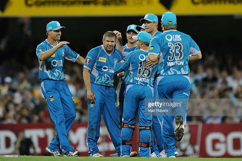 <a gi-track='captionPersonalityLinkClicked' href=/galleries/search?phrase=James+Hopes&family=editorial&specificpeople=208940 ng-click='$event.stopPropagation()'>James Hopes</a> (C) of the Heat celebrates with team mates during the Big Bash League match between the Brisbane Heat and the Hobart Hurricanes at The Gabba on December 9, 2012 in Brisbane, Australia.