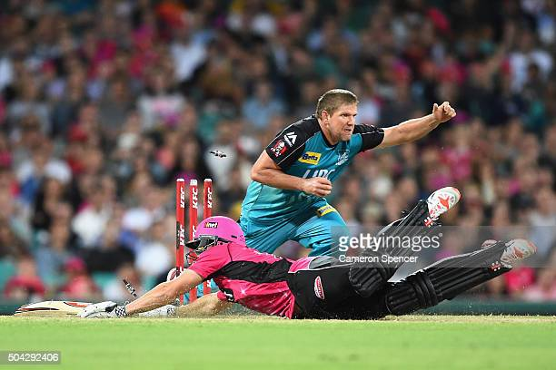 James Hopes of the Heat runs out Sean Abbott of the Sixers during the Big Bash League match between the Sydney Sixers and the Brisbane Heat at Sydney...
