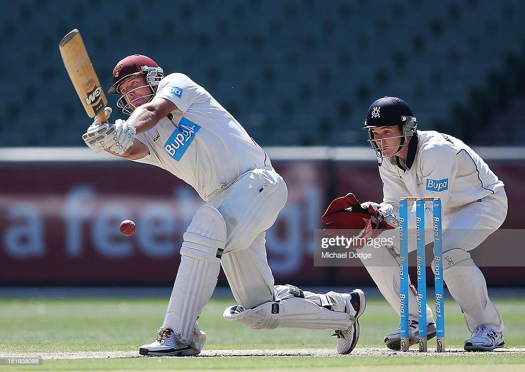 James Hopes of the Queensland Bulls hits the ball in front of Victorian Bushrangers keeper Peter Handscomb during day one of the Sheffield Shield match between the Victorian Bushrangers and the Queensland Bulls at Melbourne Cricket Ground on February 18, 2013 in Melbourne, Australia.