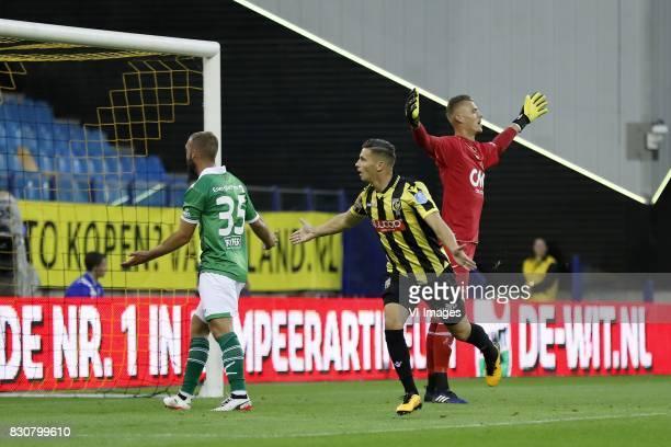 James Horsfield of NAC Breda Bryan Linssen of Vitesse goalkeeper Andries Noppert of NAC Breda during the Dutch Eredivisie match between Vitesse...