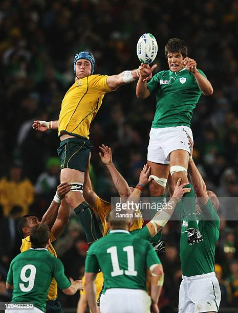 James Horwill captain of the Wallabies jumps for a lineout ball with Donncha O'Callaghan of Ireland during the IRB 2011 Rugby World Cup Pool C match...