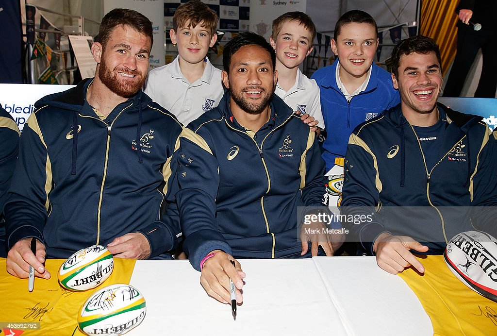 James Horwill Christian Lealiifano and Tom English pose with young fans during the Bledisloe Cup Fan Day at Fleet Park Circular Quay on August 14...