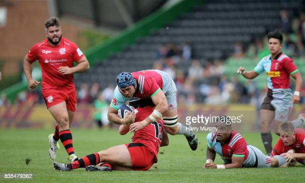 James Horwill of Harlequins is tackled by Mark Best of Jersey Reds during the pre season match between Harlequins and Jersey Red at the Twickenham...