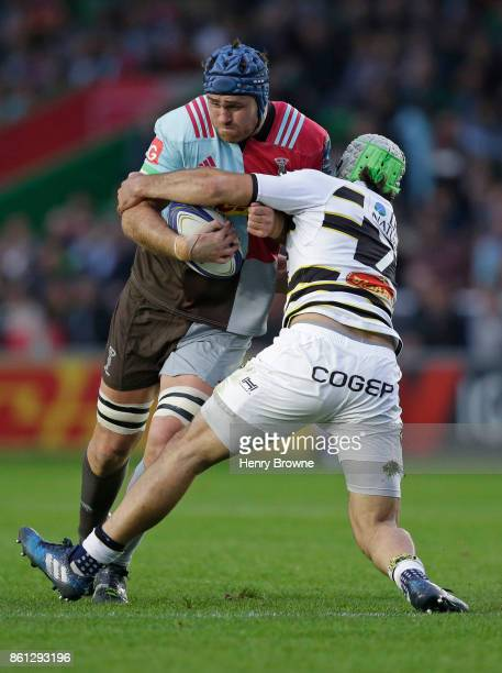 James Horwill of Harlequins tackled by Zeno Kieft of La Rochelle during the European Rugby Champions Cup match between Harlequins and La Rochelle at...