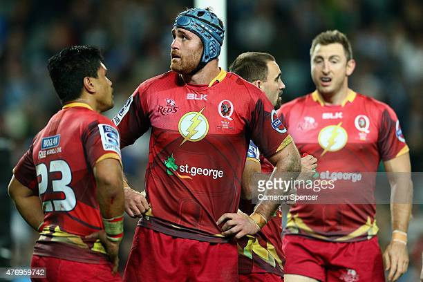 James Horwill of the Reds and team mates look dejected during the round 18 Super Rugby match between the Waratahs and the Reds at Allianz Stadium on...