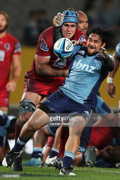 James Horwill of the Reds tackles Piri Weepu of the Blues during the round 10 Super Rugby match between the Blues and the Reds at Eden Park on April...