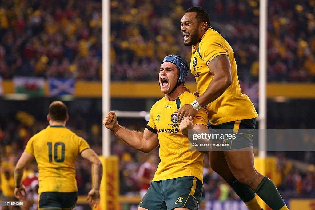 <a gi-track='captionPersonalityLinkClicked' href=/galleries/search?phrase=James+Horwill&family=editorial&specificpeople=637477 ng-click='$event.stopPropagation()'>James Horwill</a> of the Wallabies and team mate <a gi-track='captionPersonalityLinkClicked' href=/galleries/search?phrase=Sekope+Kepu&family=editorial&specificpeople=682002 ng-click='$event.stopPropagation()'>Sekope Kepu</a> celebrate winning game two of the International Test Series between the Australian Wallabies and the British & Irish Lions at Etihad Stadium on June 29, 2013 in Melbourne, Australia.