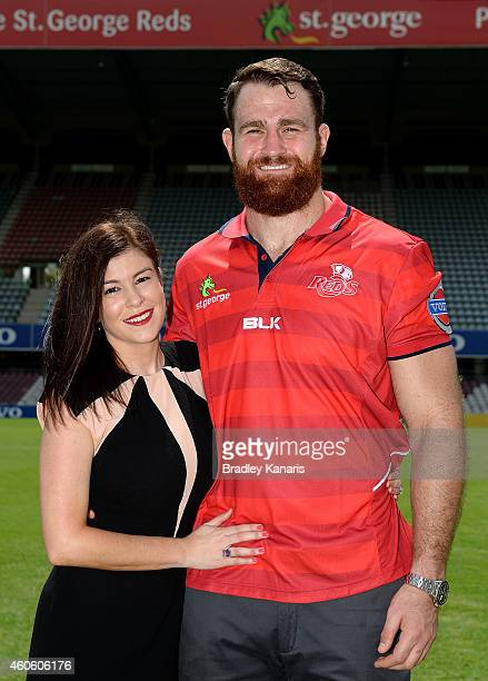 James Horwill poses for a photo with fiance Lauren Diamond after a Queensland Reds Super Rugby media announcement announcing that he has signed a...