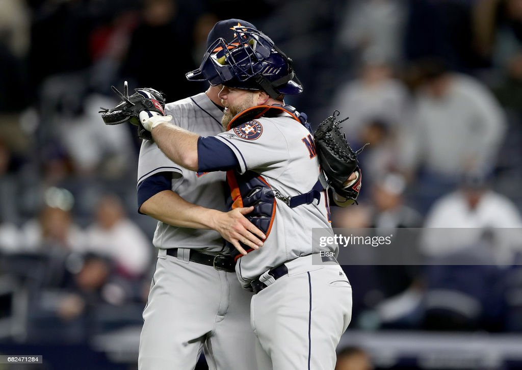 James Hoyt #51 and Brian McCann #16 of the Houston Astros celebrate the 5-1 win over the New York Yankees on May 12, 2017 at Yankee Stadium in the Bronx borough of New York City.