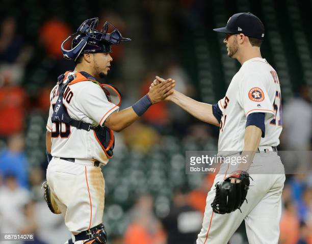 James Hoyt of the Houston Astros shakes hands with Juan Centeno after the final out against the Detroit Tigers at Minute Maid Park on May 23 2017 in...