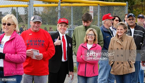 James Huffman is dressed up as US Republican presidential nominee Donald Trump as he waits to see him speak at Macomb Community College on October 31...