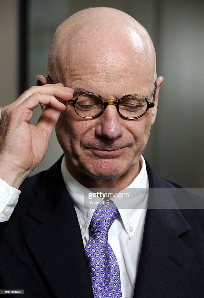 James Hughes-Hallett, chairman of John Swire & Sons Ltd., adjusts his glasses during an interview in Singapore, on Tuesday, April 9, 2013. Hong Kong home prices, the highest among major global cities, are close to peaking after more than doubling since early 2009, Hughes-Hallett said. Photographer: Munshi Ahmed/Bloomberg via Getty Images