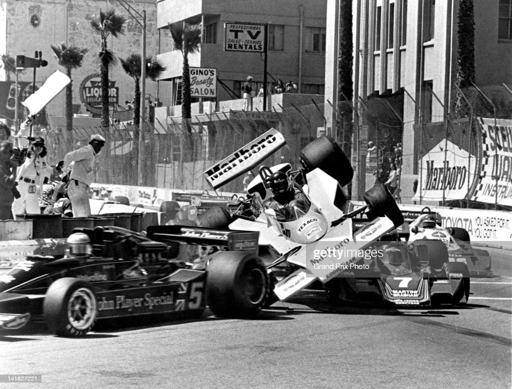 James Hunt of Great Britain and driver of the MarlboroTeam McLaren M23 Ford V8 is launched into the air after hitting the rear wheel on the Martini...