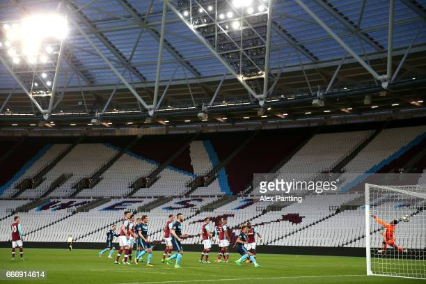 James Husband of Middlesbrough scores his sides first goal from a freekick during the Premier League 2 match between West Ham United and...