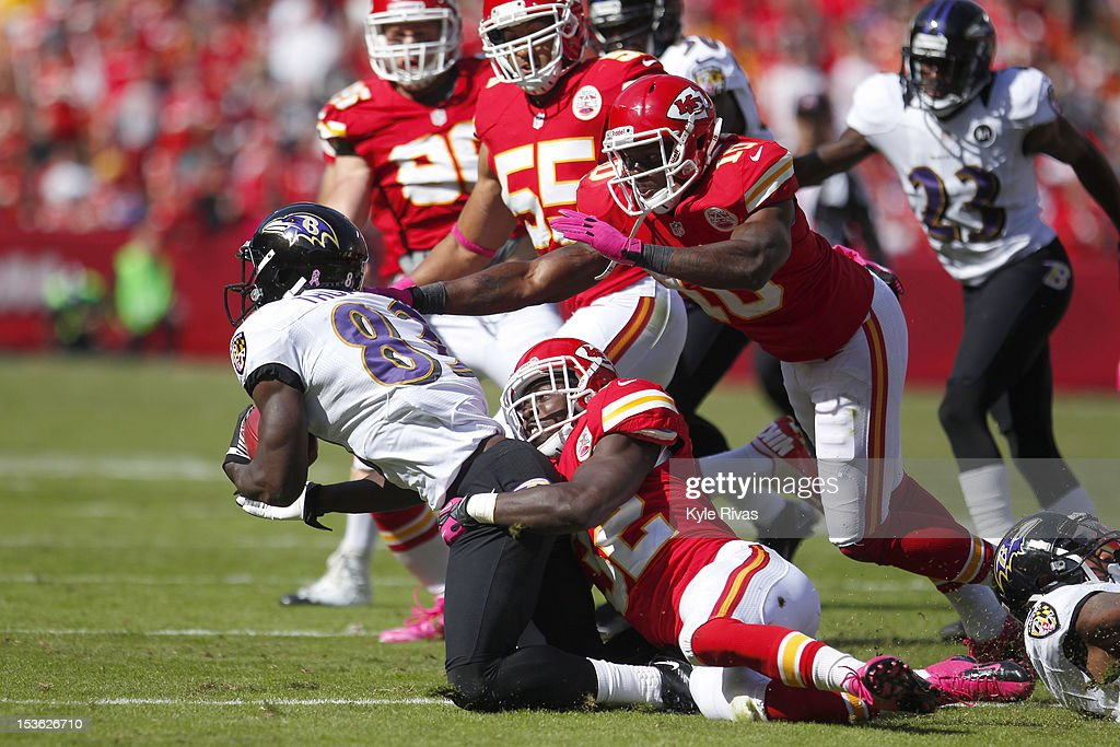 James Ihedigbo #32 is dragged to the ground by Cyrus Gray #32 of the Kansas City Chiefs late in the fourth quarter on October 07, 2012 at Arrowhead Stadium in Kansas City, Missouri.