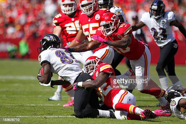 James Ihedigbo is dragged to the ground by Cyrus Gray of the Kansas City Chiefs late in the fourth quarter on October 07 2012 at Arrowhead Stadium in...